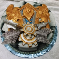 World Of Warcraft Alliance Crest   Fun cake made for a friend's birthday. Everything is hand modeled, and the color is done with an airbrush.