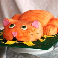 "The Cat Who Ate The Canary 3D carved cake with fondant ""feathers."""