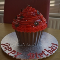 Giant Cupcake chocolate mud cake with bottom covered in melted chocolate and frosted in swiss meringue buttercream