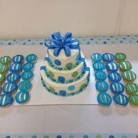 Baby Boy Cake frosted with buttercream, polka dots and bow are fondant
