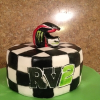Supercross Ryan Villopoto supercross cake for a friends sons birthday. Helmet was made with gumpaste and colored with edible marker and food coloring...