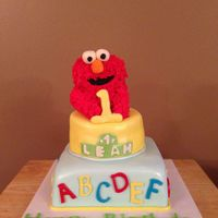 Elmo 1St Birthday 8in square, 6in roundcovered in MMF with all MMF deocrationsElmo is RKT covered in Royal icing