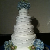 Hydrangea Cake   white fondant covered with real floral accents