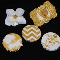 Golden Anniversary Collection Inspired by gold and white, this collection contains a gumpaste frame and rose and other fondant decorations.
