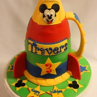 Micky Mouse Space Rocket A 7-layer cake modeled after a child's favorite toy, the Micky Mouse Space Rocket.