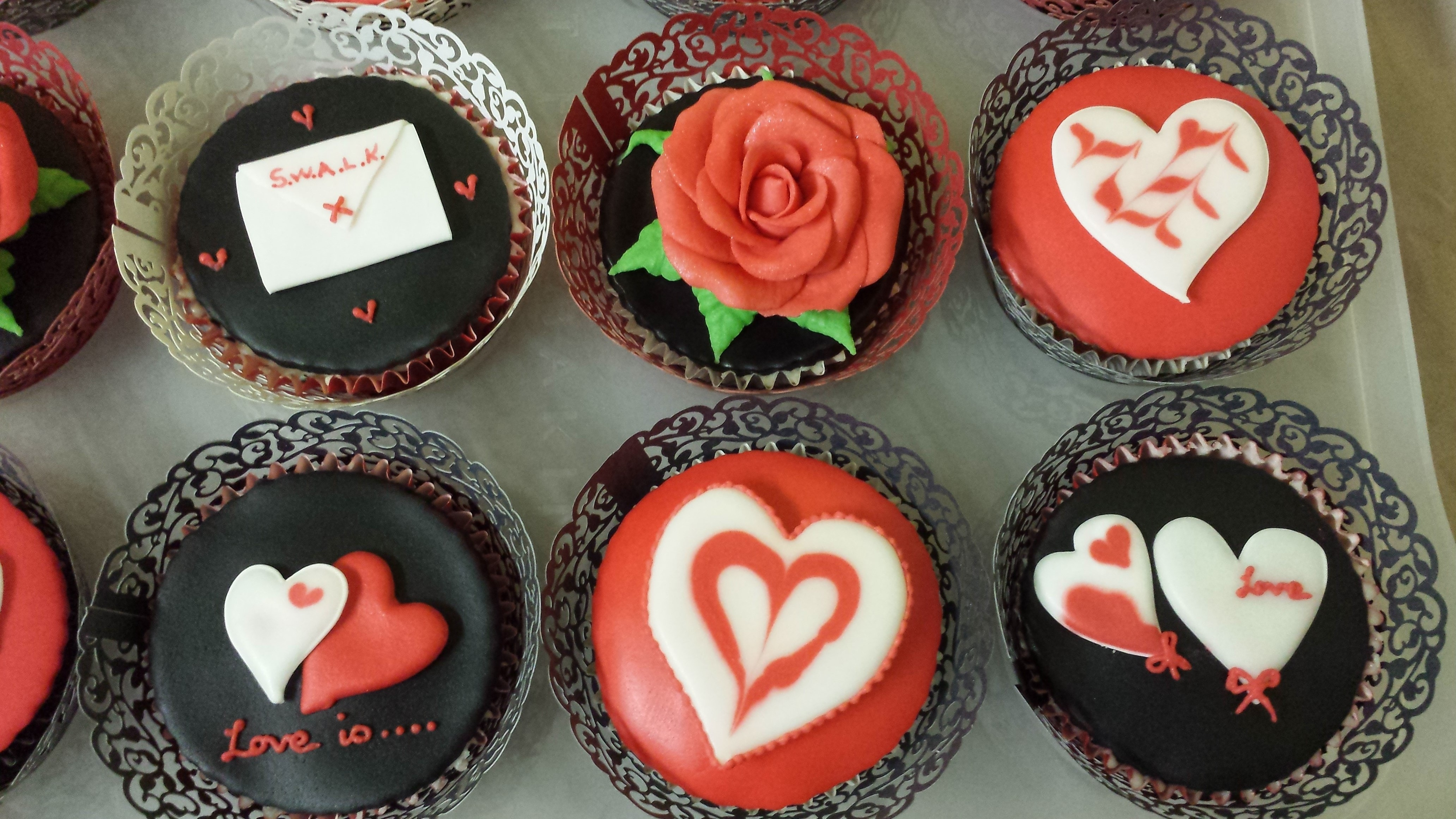 Valentine Cup Cakes Modelling Paste Roses And Royal Icing Hearts Valentine cup cakes, modelling paste roses and Royal Icing hearts.