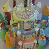 Princess Castle Cake. Lollipops, candies, and marshmallow sticks were used to embellish cake