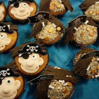 Pirate Cupcakes And Wood Washed Up Wreck Of A Pirate Ship On The Beach With Coins Pearls And Bones Pirate cupcakes and wood washed up wreck of a pirate ship on the beach with coins, pearls and bones...