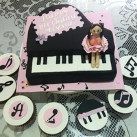 Piano Cake A main piano cake plus 7 cupcakes (which is for 7 yr birthday). The little girl was kind of like the real bday girl :)