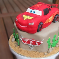 Lightning Mcqueen Cake Car was made by RKT, covered with modelling chocolate and then fondant. The rock was chocolate mud cake. Thanks heaps for Lingin's...
