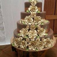 4 Tier Chocolate Fondant Covered Wedding Cakes With Hand Painted Golden Roses *4 Tier Chocolate fondant covered Wedding cakes with hand-painted golden Roses