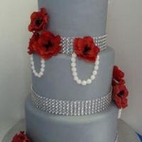 3 Tier All Double Barrel Chocolate Cakes Covered With Greysilver Fondant Decorated With Fondant Pearls And Red Fondant Flowers Made A 3 Tier - all double barrel chocolate cakes covered with grey/silver fondant , decorated with fondant pearls and red fondant flowers - made...