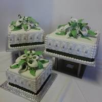 3 Tier Wedding Cake With Calla Lelies And Green Ribbon 3 Tier Wedding cake with Calla Lelies and green ribbon