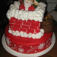 Santa The bottom tier is dark chocolate with candy cane smbc. The top is lemon with lemon smbc . ( for me ...I love lemon cake and don't...