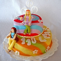 Hippie Cake This is two tier birthday cake for two hippies, covered with fondant, both hippies are also made out of fondant.