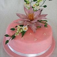 Flower This is an elegant BD cake, covered with fondant. Flowers are hand made out of fondant and inspired by Alan Dunn.