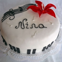 Music Themed Bd Cake It's a music themed cake for 24th BD, covered with fondant, simple lily is also made out of fondant.