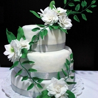 Green And White 25Th Wedding Anniversary Cake Green and white 3-tier 25th wedding anniversary cake, covered with fondant. Flowers are hand made, inspired by Alan Dunn.