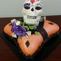 Dia De Los Muertos I painted by hand , celebrating the occasion with my co-workers, this is a vanilla cake with strawberry filling and rum , with cherimoya...