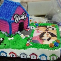Dog House Cake Made for a co-workers daughter who loves her dog, Oti, more that anything in this world.