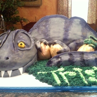 Dinosaur dinosaur cake for my nephew. body is chocolate, head is yellow and tail is RKT
