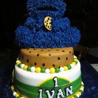 Cookie Monster First Birthday Cake :) 3 tiered cookie monster cake, bottom tier chocolate fudge with marshmallow buttercream filling, 2nd and 3rd tiers WASC covered in...
