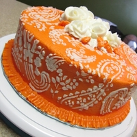 Orange Paisley Cake This was supposed to be my first air brushed cake... I completely messed it up and got major dark blue ( it was supposed to be sky blue,...