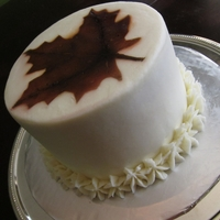 1322175023.jpg Simple Leaf Design Airbrushed Cake (my first :)). Mocha chocolate cake with Bailey's Irish Cream Buttercream Frosting.