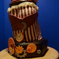 Steampunk Cake This was my birthday cake. Gears, Fan, Watch were all made from gumpaste. Top hat was made with chocolate cake with carmel/snicker filling...