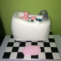 Pink Rubber Duck Shower Cake   The ducks are made out of chocolate, the faucet and handles are gumpaste.
