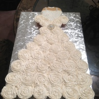 Cupcake Wedding Dress For A Bridal Shower Bodice Is A Heart Shape Cake Covered With Fondant While The Cupcakes Are Frosted With Buttercrea... Cupcake wedding dress for a bridal shower. Bodice is a heart shape cake covered with fondant, while the cupcakes are frosted with...