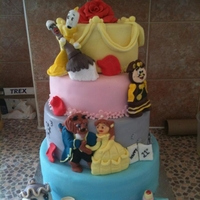 Beauty And The Beast   4 tier cake inspired by Cakes by Renato. all figures are hand made from fondant