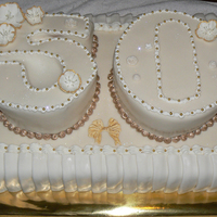 50Th Wedding Anniversary Vanilla cake filled with Mango Mousse. The pleats took forever to put on the cake.