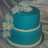 Tropical Wedding Cake 10 and 8 inch wedding cake with gumpaste orchids
