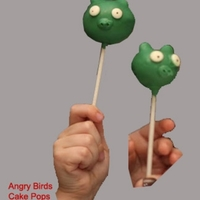Angry Birds Cake Pop These cake pops were made with chocolate cake, green candy melts, white mini chips and edible writing pens. Please disregard the tiny hands...