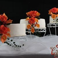 Autumn Wedding Cake Round wedding cake, with autumn inspiration... orange roses, calla lilies and beeriesthanks for looking