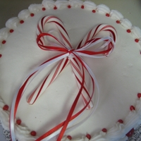 Peppermint Christmas Cake This is a peppermint cake that is flavored with peppermint and has peppermint butter cream icing and crushed peppermint in the filling.