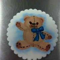 Hand Painted Teddy For A Cake   Painted with food colours. Plaque with a teddy on to put on a cake or cupcake