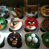 Angry Birds Cupcakes Not a cake, but cupcakes. This hand molded and hand painted set are by far the cutest little pieces of art that I have ever made. Thanks...