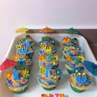 Beach Day Cupcakes Confetti Cupcakes with Cotton Candy Flavored Frosting covered in Graham Cracker Sand