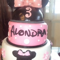 Minnie Mouse  Cream cheese cakes 8, 6 and 5. Ears and bow are made out fo fondant. Thanks to The Royal Bakery for the great minnie mouse tutorial which I...