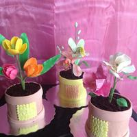 Flowers Pots Cream cheese cake with crushed oreo cookies simulating soil with sugar flowers
