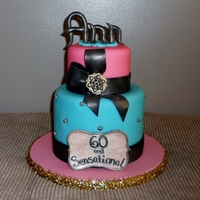60 And Sensational ! Vanilla Bean Cake with vanilla butter cream. Finished in fondant with fondant decorations