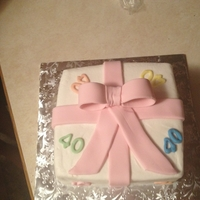 40Th Present Cake buttercream icing with fondant bow, ribbon, and 40s