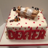 Dexter Cake In Buttercream With Fondant Figures Dexter cake in buttercream with fondant figures