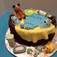 Baby Basket oval cake with basket weave and gum paste figures
