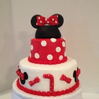 Butter Cream Cake With Fondant Accents Minnies Hat Is Covered In Fondant With Fondant Bow Butter cream cake with fondant accents, Minnie's hat is covered in fondant with fondant bow.