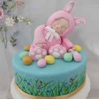 Easter Bunny Baby Handmade fondant cute baby on a hand painted cake