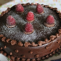 Chocolate Birthday Cake   Chocolate ganache cake with fresh raspberries, simply delicious!