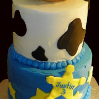 Toy Story Top cake is vanilla, bottom is chocolate. I made the centre of the cake with rice krispie treats and covered in fondant, then sprayed with...